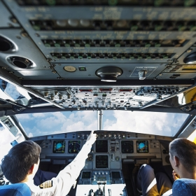 Pilots interacting in a plane cockpit
